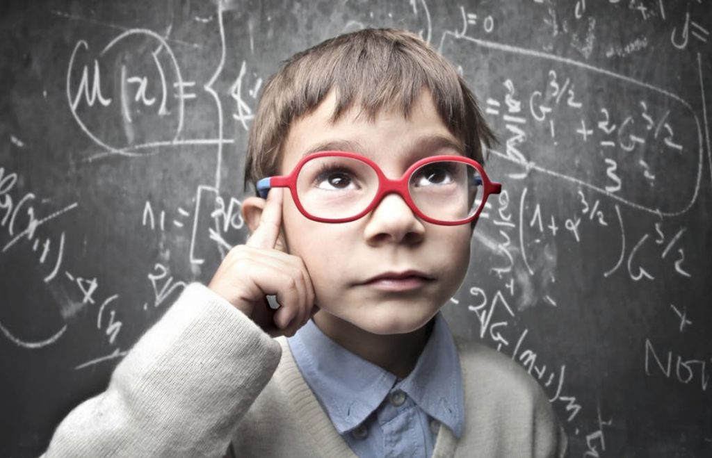 Easiest Framework - Child with glasses in front of blackboard