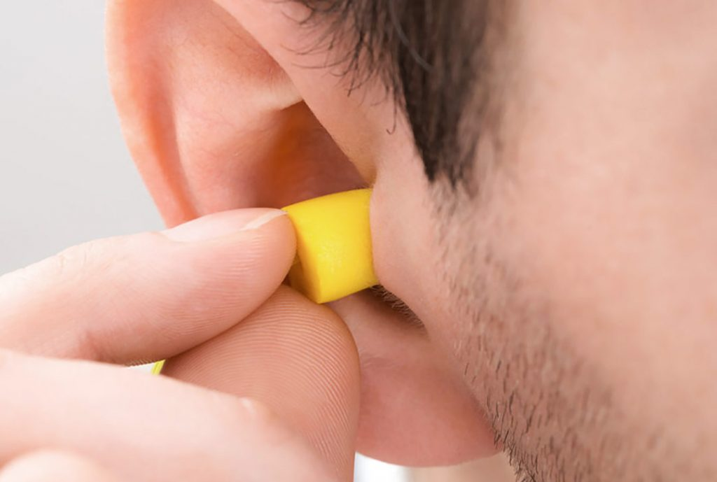 Person Ear With Earplug