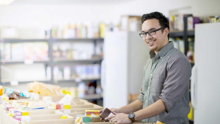 Decision Science | Arts & Culture Fundraising | Man volunteering at a food bank - slide